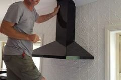 Sandie's Brother John installing the rangehood