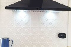 The black rangehood and accents look spectacular