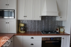 The Lily pattern installed as a stunning kitchen splashback