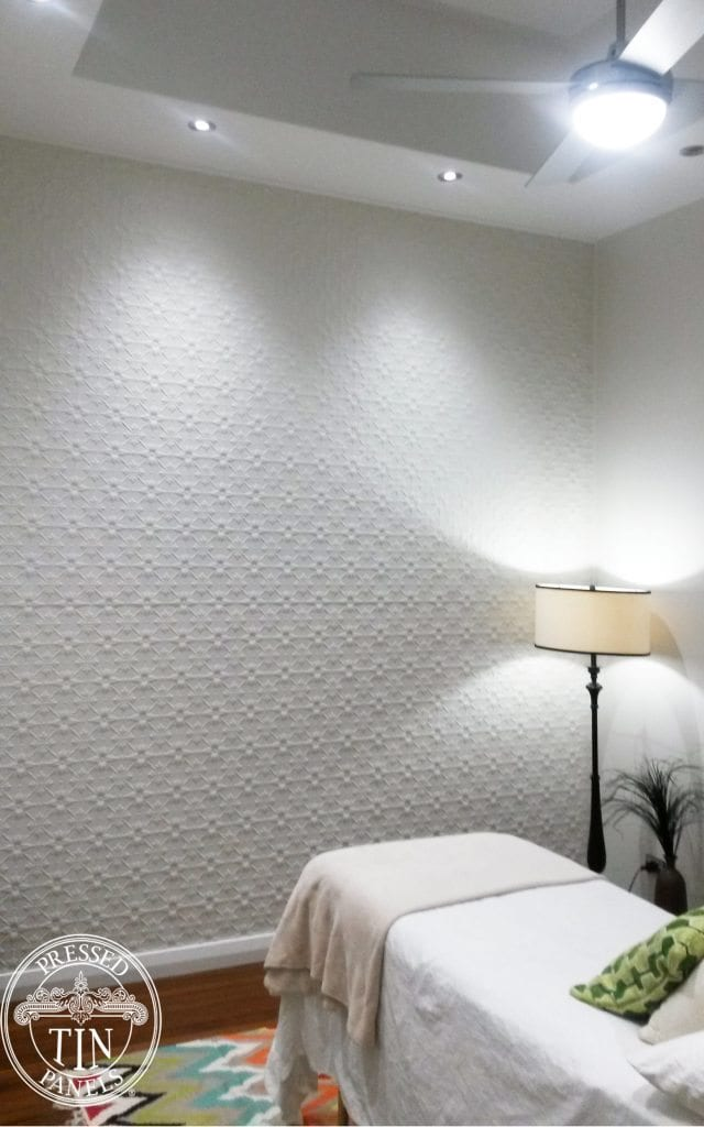 pressed tin panels original pattern in Whit Satin installed as a feature wall