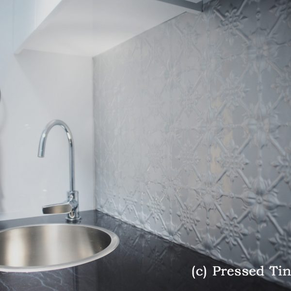 Pressed Tin Panels 'Original' pattern in Mercury Silver powder coat as laundry splashback