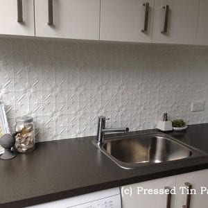 Pressed Tin Panels Original pattern used as a laundry splashback