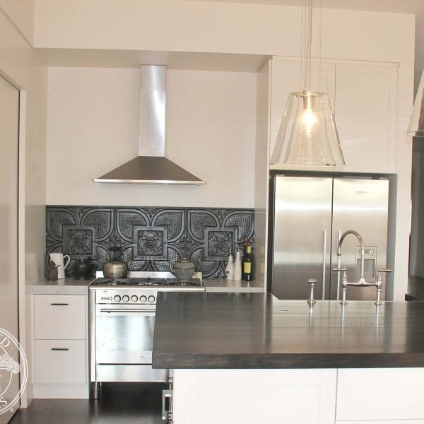 Pressed Tin Panels 'Alexandria' pattern in black powder coat, installed as a kitchen splashback.