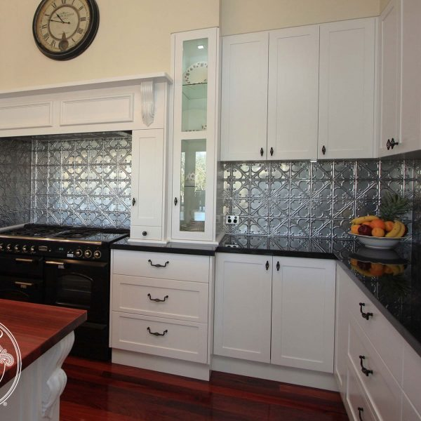 Pressed Tin Panels 'Snowflakes' pattern in silver powder coat, installed as a kitchen splashback by Flair Cabinets.