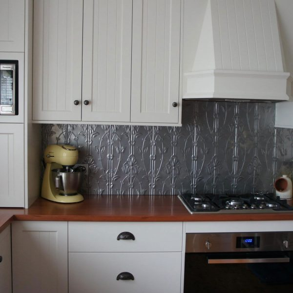 Pressed Tin Panels 'Lily' pattern powder coated in Mercury Silver and installed as a kitchen splashback