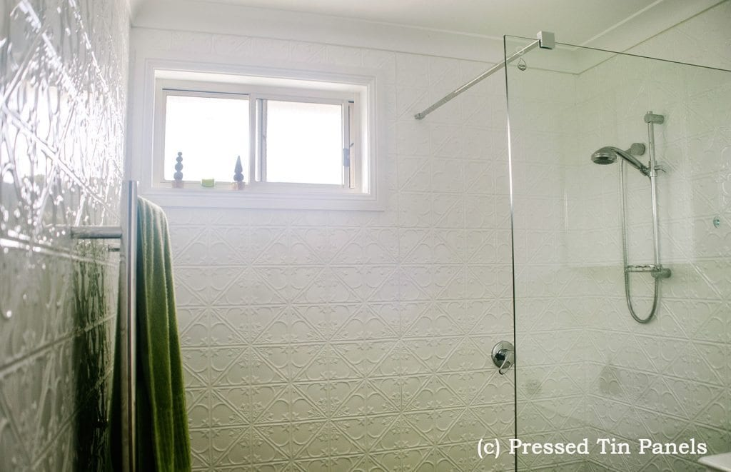 Pressed Tin Panels Snowflakes pattern installed in Bathroom shower recess powder coated in Classic White.