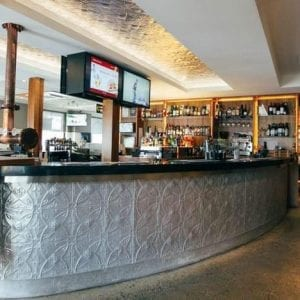 Pressed Tin Panels Carousel pattern installed in the bar front and ceiling at the QA Hotel in Brisbane QLD