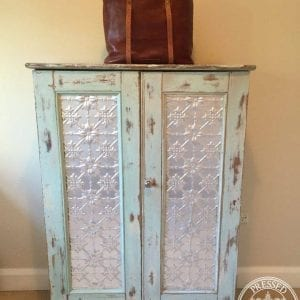Pressed Tin Panels Original pattern installed on this tall boys door inserts