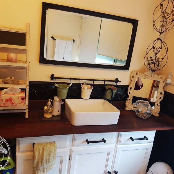 Image example of Pressed Tin Panels Clover pattern powder coated Black Gloss & installed into a bathroom.