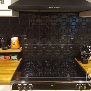Pressed Tin Panels Evans pattern in black gloss powder coat installed as cooktop splashback