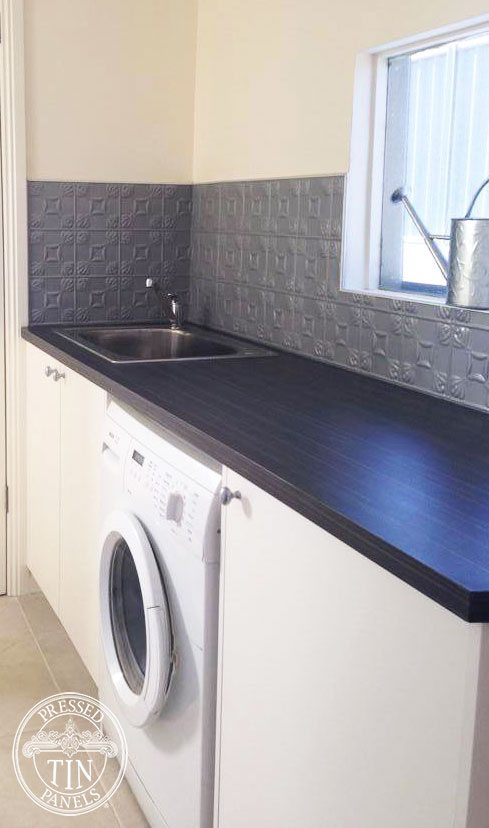 Image example of Pressed Tin Panels Evans pattern, powder coated silver and installed as a laundry splashback