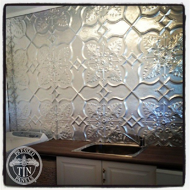 Image example of Pressed Tin Panels Shield pattern painted with aluminium coloured paint and installed as a laundry splashback
