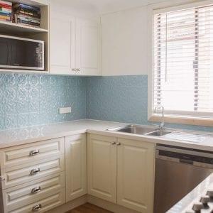 Kitchen splashback image example of Pressed Tin Panels Spades pattern powder coated in Misty Blue