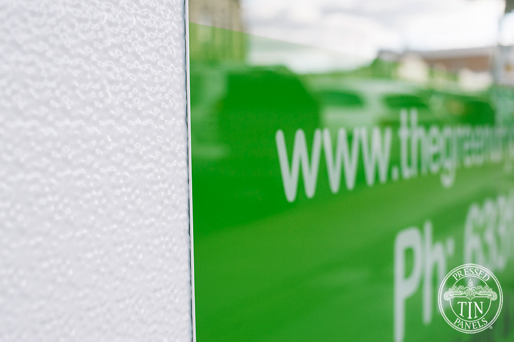 PressedTinPanels_RoughCastSmall_WhiteExteriorRetailCladding_GreenDryClean