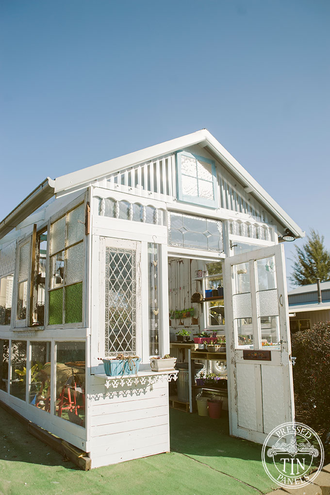 A glass house that features pressed metal