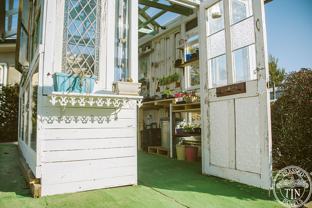 This lovely glass house features lots of pressed metal off-cuts including Original on the door