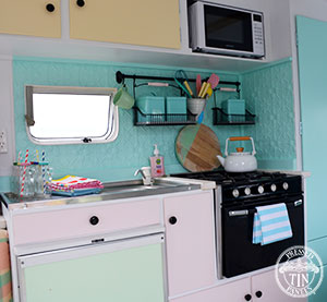 Original panel featured as caravan kitchen splashback
